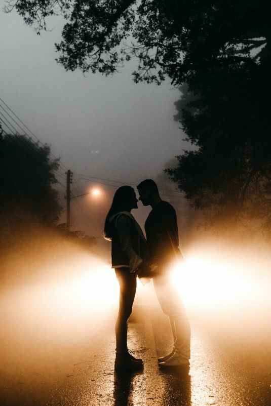photo of couple standing on road
